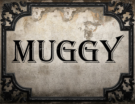 muggy: muggy word on concrette wall Stock Photo