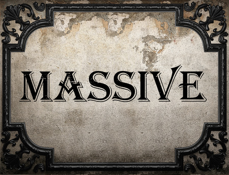 massive: massive word on concrette wall Stock Photo