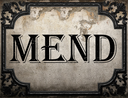 to mend: mend word on concrette wall