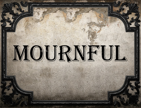 mournful: mournful word on concrette wall