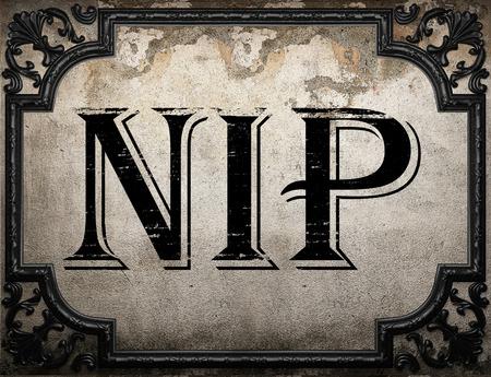 nip: nip word on concrette wall Stock Photo