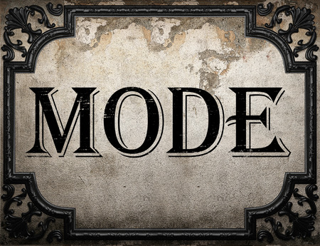 mode: mode word on concrette wall Stock Photo