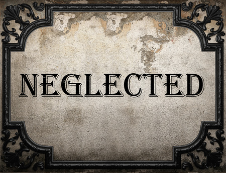neglected: neglected word on concrette wall Stock Photo