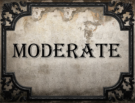 moderate: moderate word on concrette wall Stock Photo