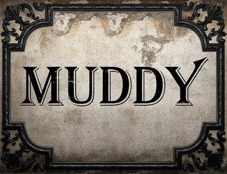 muddy: muddy word on concrette wall