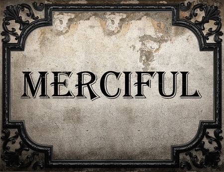 merciful: merciful word on concrette wall Stock Photo