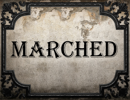 marched: marched word on concrette wall