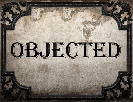 objected: objected word on concrette wall