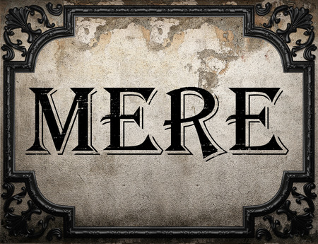 mere: mere word on concrette wall