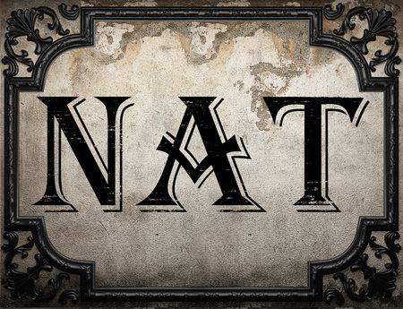 nat: nat word on concrette wall Stock Photo