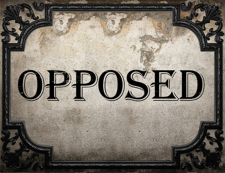 opposed: opposed word on concrette wall