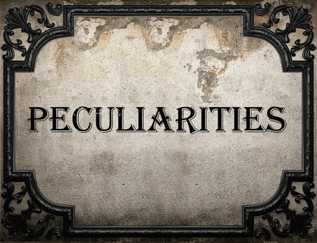 peculiarities: peculiarities word on concrette wall