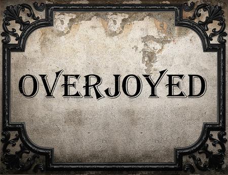 overjoyed: overjoyed word on concrette wall Stock Photo