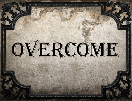 overcome: overcome word on concrette wall