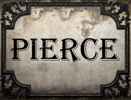 pierce: pierce word on concrette wall