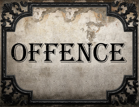 offence: offence word on concrette wall