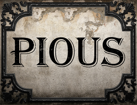 pious: pious word on concrette wall Stock Photo