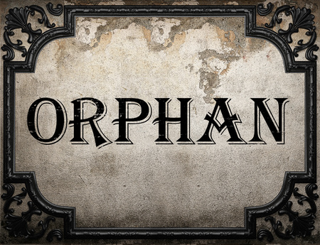 orphan: orphan word on concrette wall Stock Photo