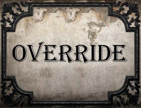 override: override word on concrette wall Stock Photo
