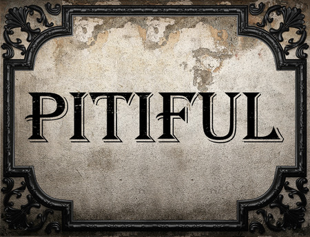 pitiful: pitiful word on concrette wall Stock Photo