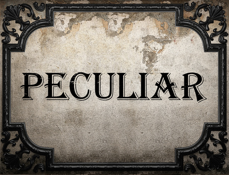 peculiar: peculiar word on concrette wall