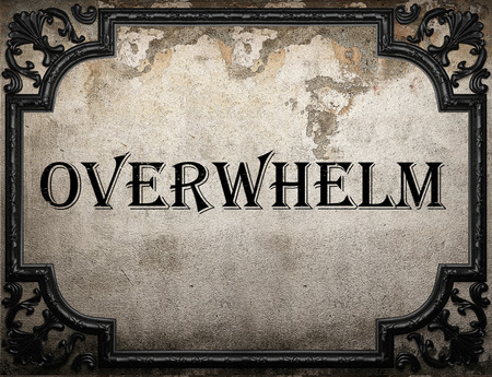 overwhelm: overwhelm word on concrette wall