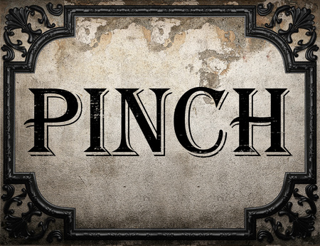 pinch: pinch word on concrette wall Stock Photo