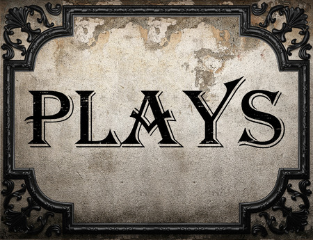 plays: plays word on concrette wall