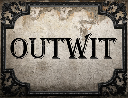 outwit: outwit word on concrette wall Stock Photo