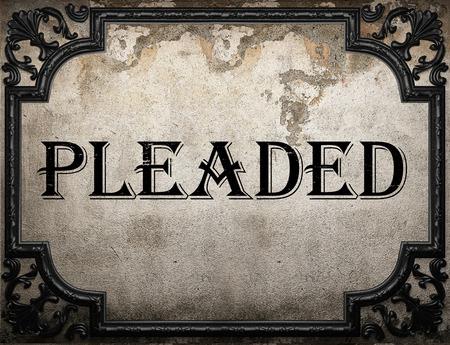 pleaded: pleaded word on concrette wall