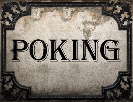 poking: poking word on concrette wall