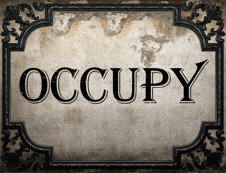occupy: occupy word on concrette wall