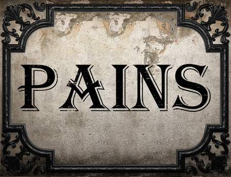 pains: pains word on concrette wall Stock Photo