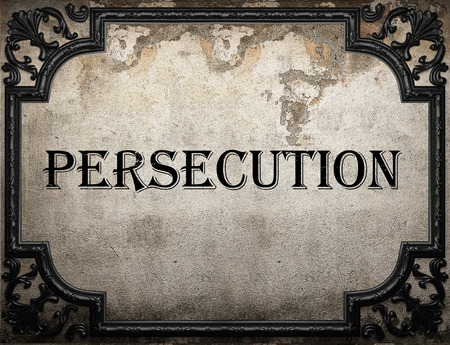 persecution: persecution word on concrette wall