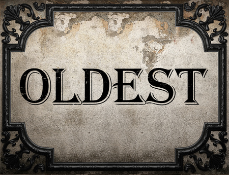 oldest: oldest word on concrette wall Stock Photo