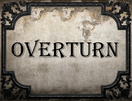 overturn: overturn word on concrette wall