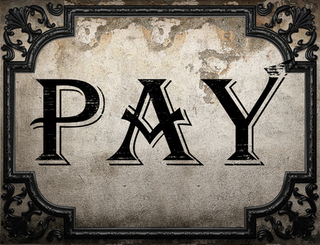 pay wall: pay word on concrette wall Stock Photo
