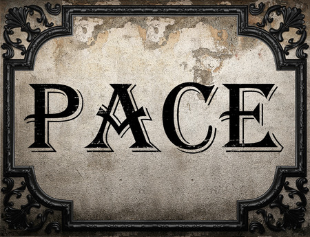 pace: pace word on concrette wall Stock Photo