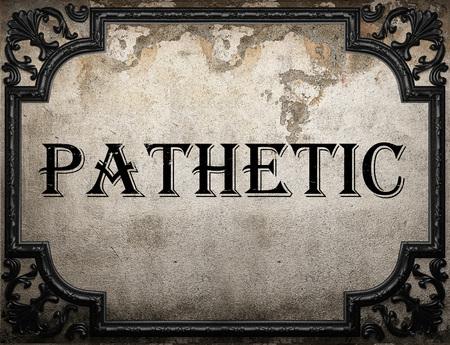 pathetic: pathetic word on concrette wall Stock Photo
