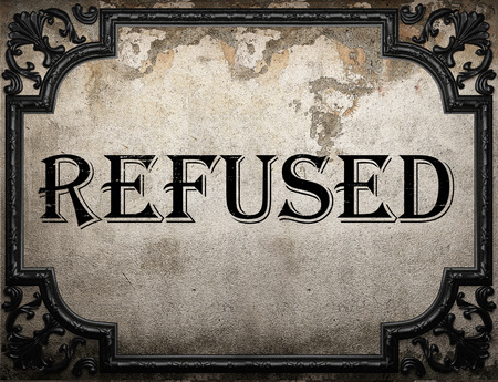 refused: refused word on concrette wall