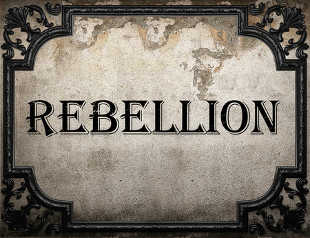 rebellion: rebellion word on concrette wall Stock Photo