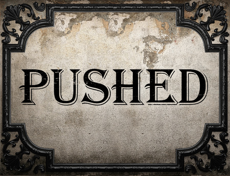 pushed: pushed word on concrette wall
