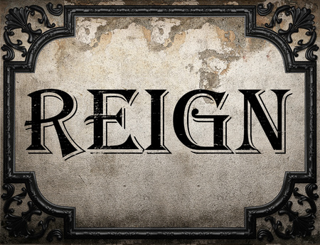 reign: reign word on concrette wall Stock Photo