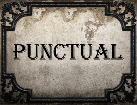 punctual: punctual word on concrette wall