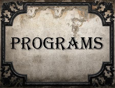 programs: programs word on concrette wall
