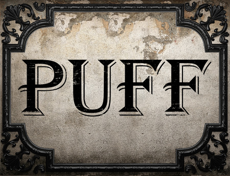 puff: puff word on concrette wall Stock Photo