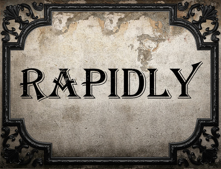 rapidly: rapidly word on concrette wall