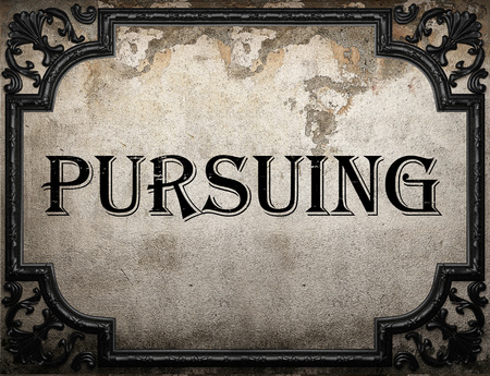 pursuing: pursuing word on concrette wall