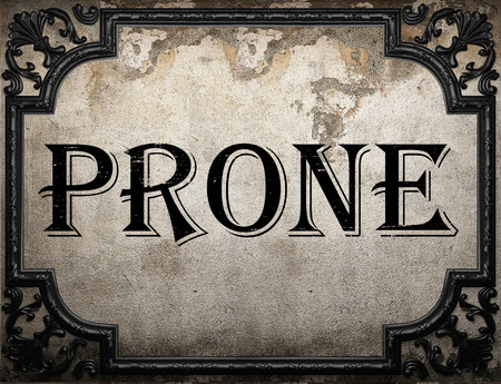 prone: prone word on concrette wall