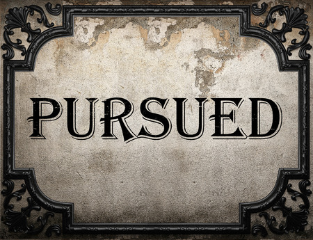 pursued: pursued word on concrette wall Stock Photo